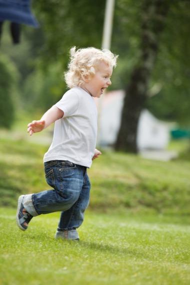 Boy running in garden